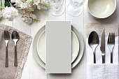 Table card mockup, menu mockup.  Vintage fashion photography. Wedding dinner design. Place card, reserved card. Beautiful dishware, traditional style.