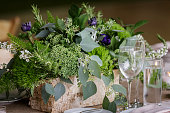 wedding table centerpiece with a lot of green