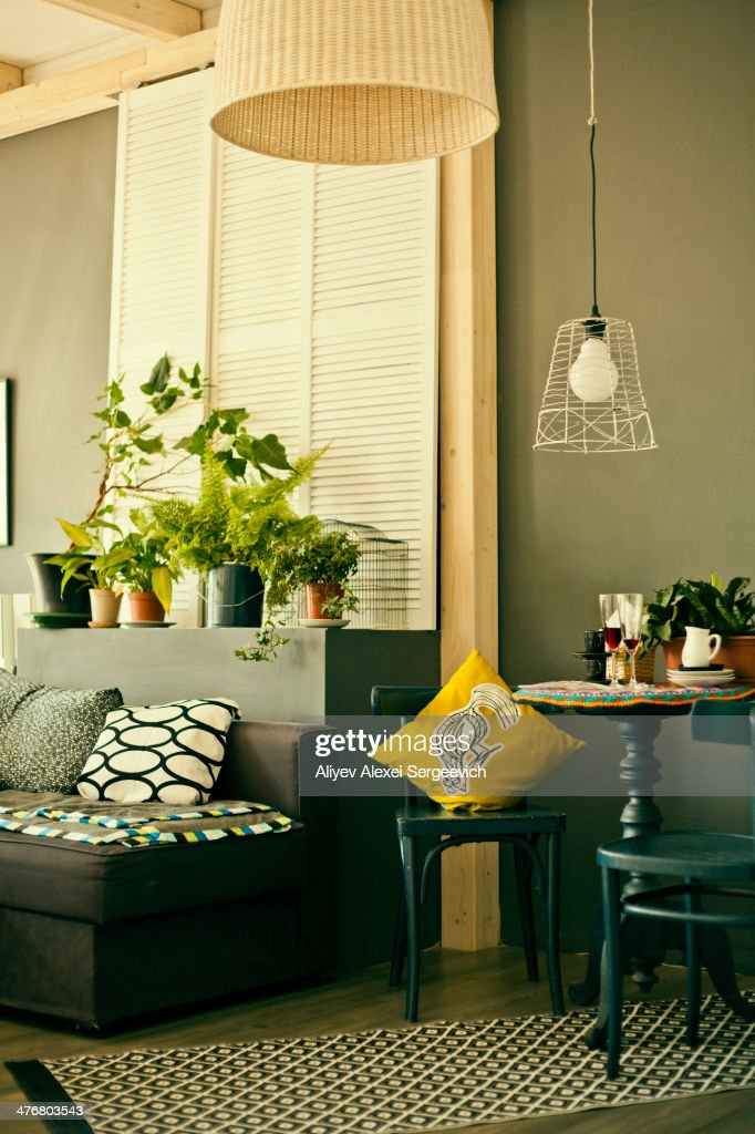 Table, chairs and sofa in modern living room : Stock Photo