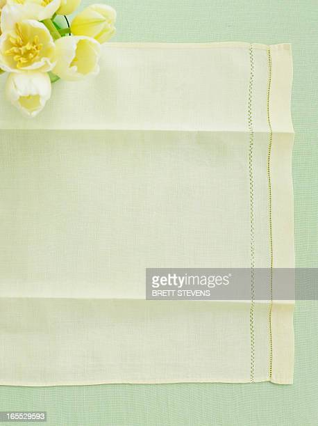Table cloth with vase of tulips