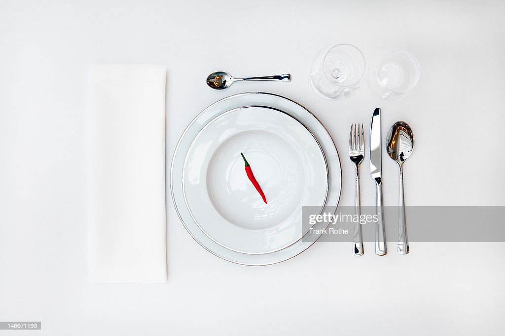 table cover with a red pepper on the upper plate : Stock Photo