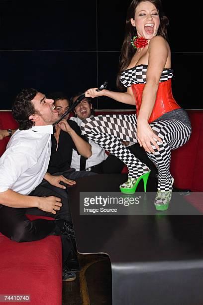 Table dancer pulling mans tie