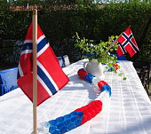 Decoratede table for Norwegian constitution day 17th of May with norwegain flags