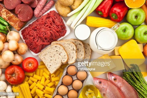 Table filled with different types of foods shot directly above stock photo - Different types of entrees ...