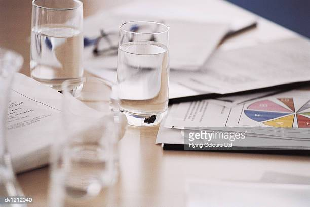 Table in a Meeting Room With Documents and Paperwork on Top of it