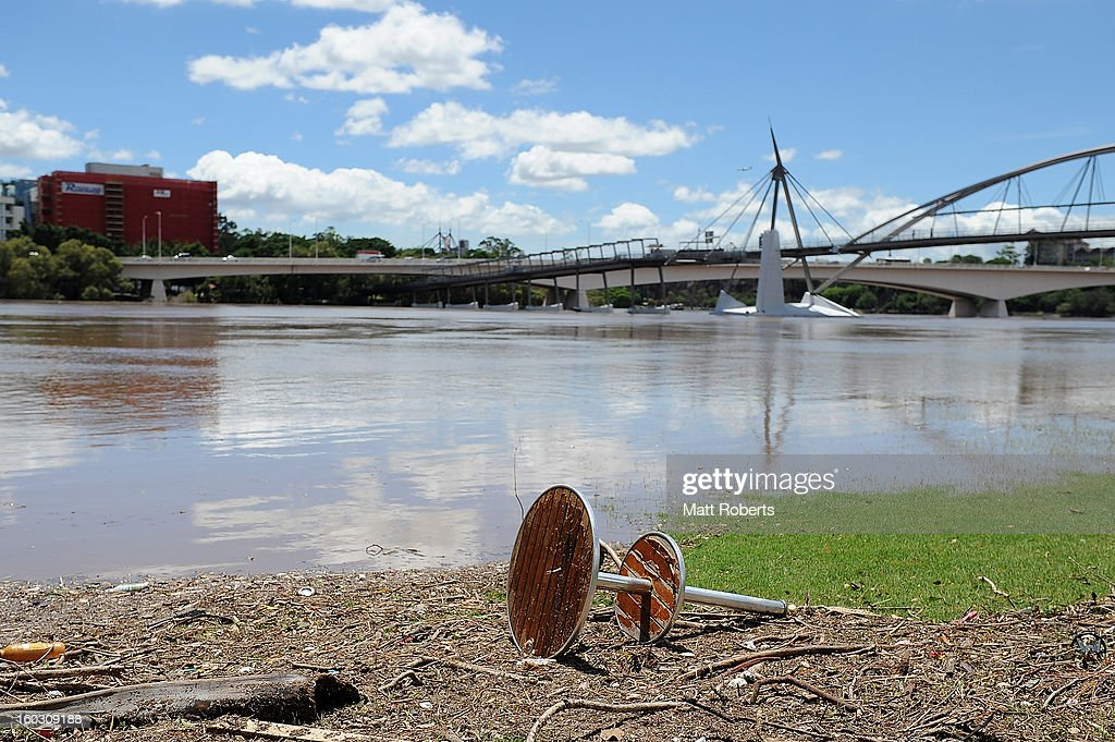 A table is seen washed up at South Bank as parts of southern Queensland experiences record flooding in the wake of Tropical Cyclone Oswald on January 29, 2013 in Brisbane, Australia. The river in the Brisbane CBD is expected to peak at 2.3 metres today - lower than the 2.6 metre peak predicted - but is still likely to flood low-lying properties and businesses. The flood crisis has claimed four lives so far, with the city of Bundaberg, Queensland faces the worst flooding in its history.