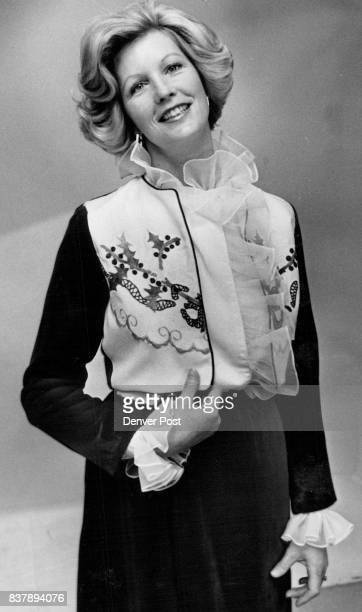 Table linen gaily embroidered with holly is vest for Mary Middleton's red velveteen jacket Credit Denver Post