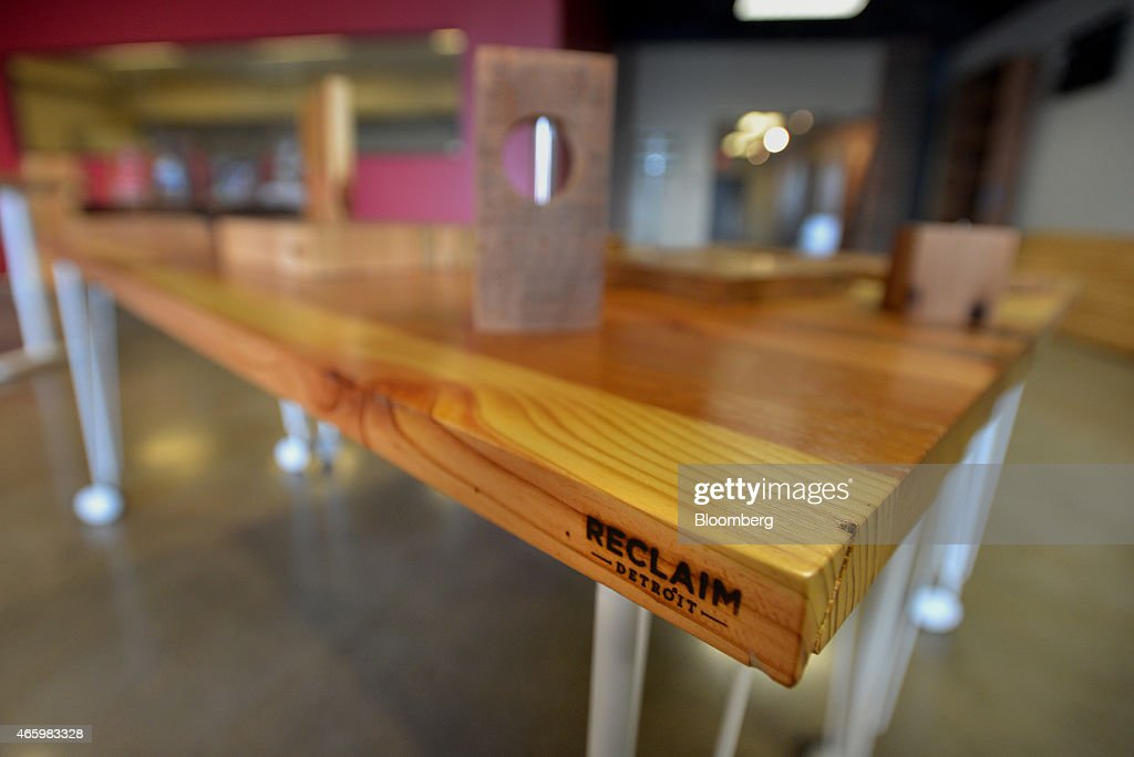 A table made with reclaimed wood is displayed and available for purchase at  the Reclaim Detroit - Detroit's Vacant Houses Provide Prized Wood For Guitar Makers