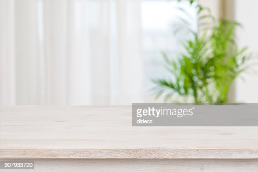 Table mockup for display of product over blurred window background : Stock Photo