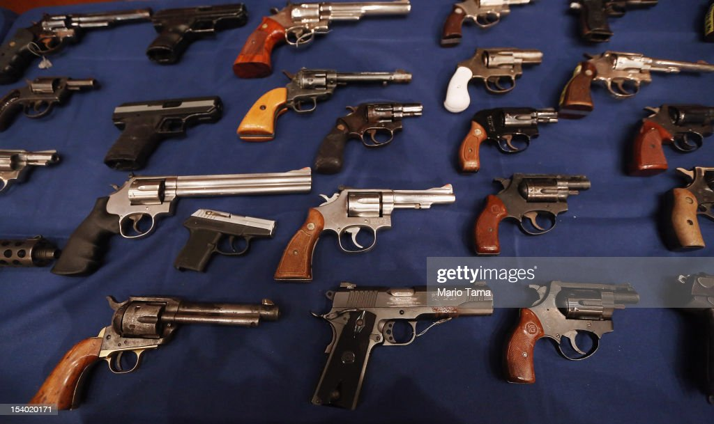 A table of illegal firearms confiscated in a large weapons bust in East Harlem are on display at a press conference on October 12, 2012 in New York City. NYPD detectives arrested 13 suspects for the illegal sale of 129 guns mostly purchased from gun dealers and pawn shops in South Carolina.