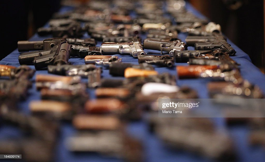 A table of illegal firearms confiscated in a large weapons bust in East Harlem is on display at a press conference on October 12, 2012 in New York City. NYPD detectives arrested 13 suspects for the illegal sale of 129 guns mostly purchased from gun dealers and pawn shops in South Carolina.