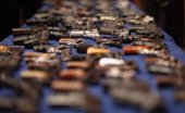 A table of illegal firearms confiscated in a large weapons bust in East Harlem is on display at a press conference on October 12 2012 in New York...