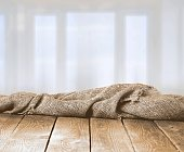 Burlap texture on wooden table on blurred
