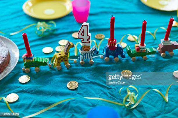 Table prepared for child's 4th birthday party