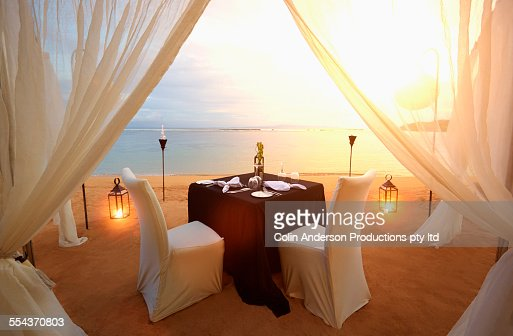 Table prepared for romantic dinner at beach