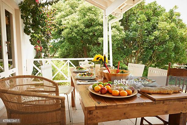 Table prepared with healthy food on veranda