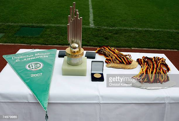 A table presents the winning trophee the winning medals and a pennant of the German Football Association during the Men's B Juniors Championship...