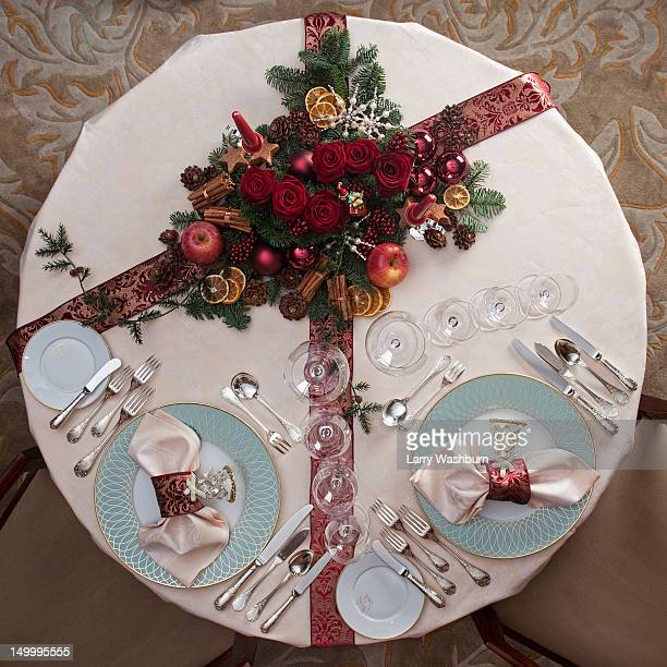 A table set for a Christmas dinner for two