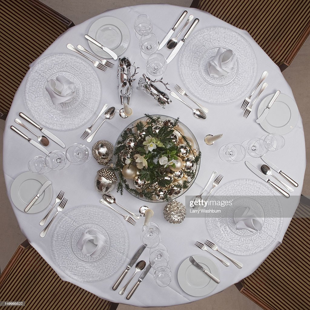 A table set for a formal dinner for four : Photo
