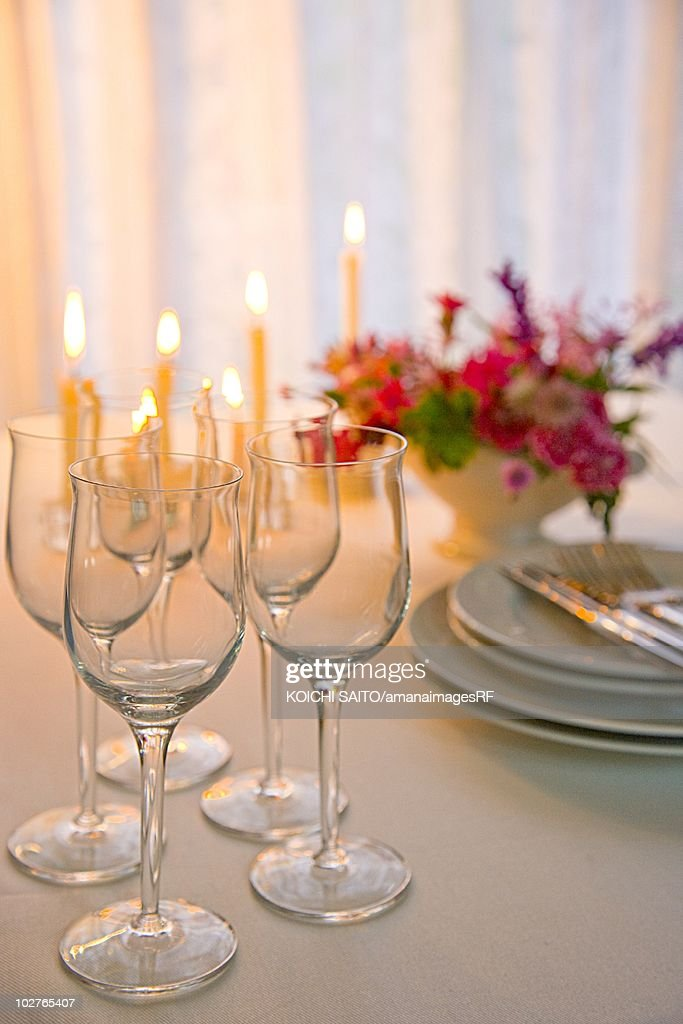 Table set for Christmas dinner with a centerpiece : Stock Photo