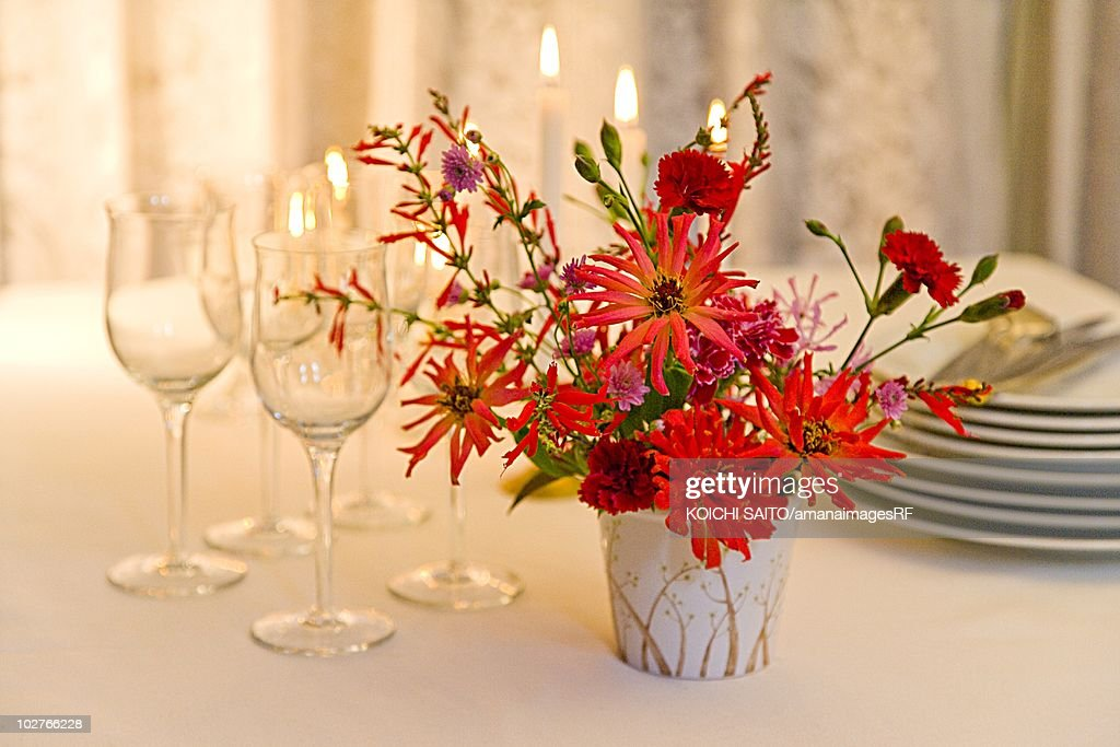 Table Set For Christmas Dinner With A Centerpiece Stock