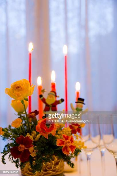Table set for Christmas dinner with a centerpiece