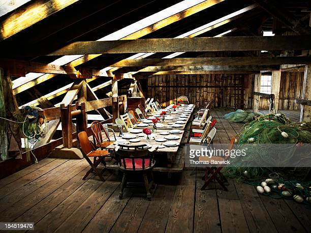 Table set for dinner inside rustic net shed