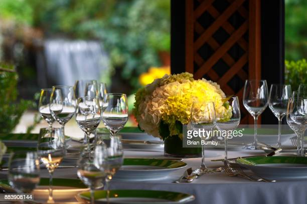 Table set for event with flowers, glasses and plates