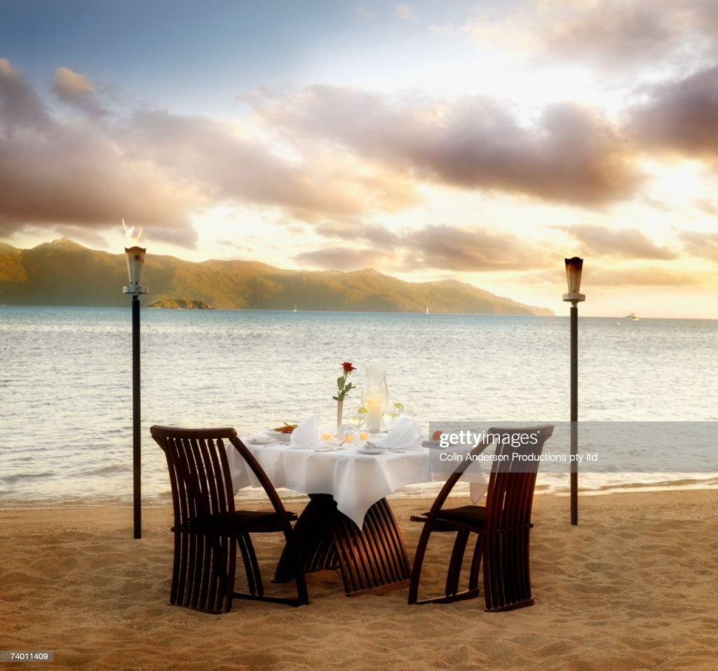 Table set for two at beach : Stock Photo