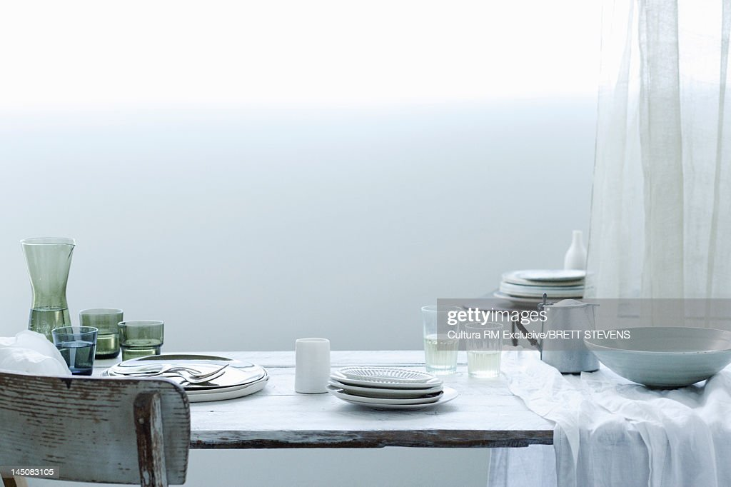 Table set with dishes and cups