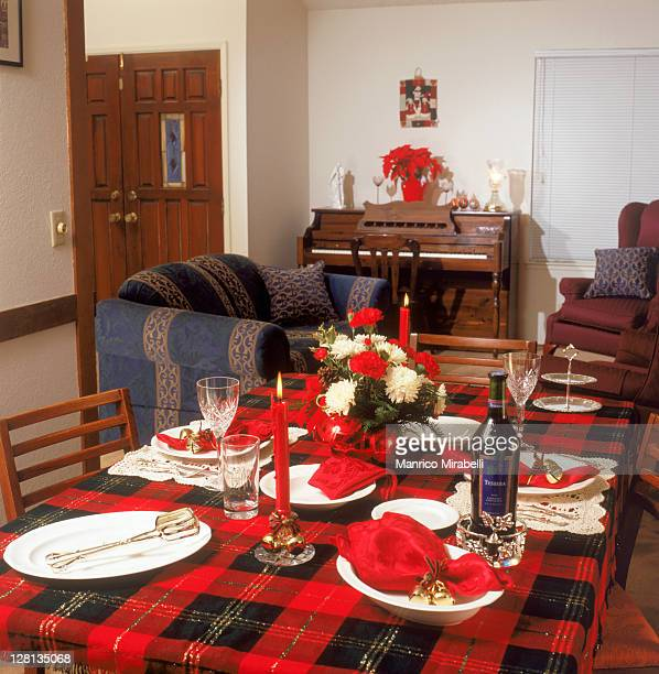 Table setting for holiday dinner with piano and so