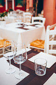 Table setting in restourant terrace. Wine glass, tablecloth