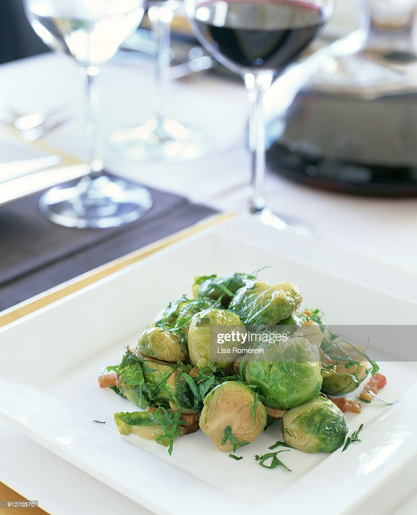 Table setting with bacon roasted brussel sprouts : Stock Photo