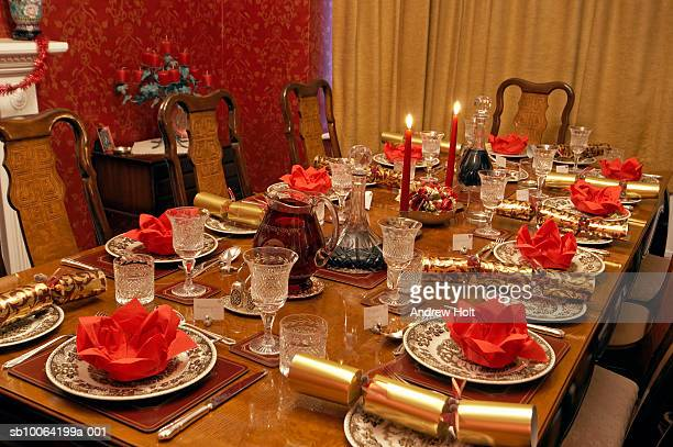 Table setting with candles and Christmas crackers