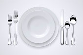 Table setting with clipping path for the plates, forks, spoons and knife.