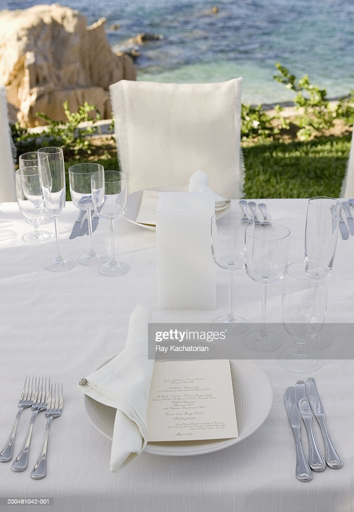 Table setting with invitation : Stock Photo