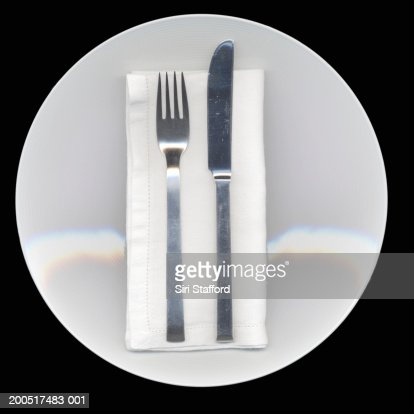 Table setting with plate, napkin, and silverwear
