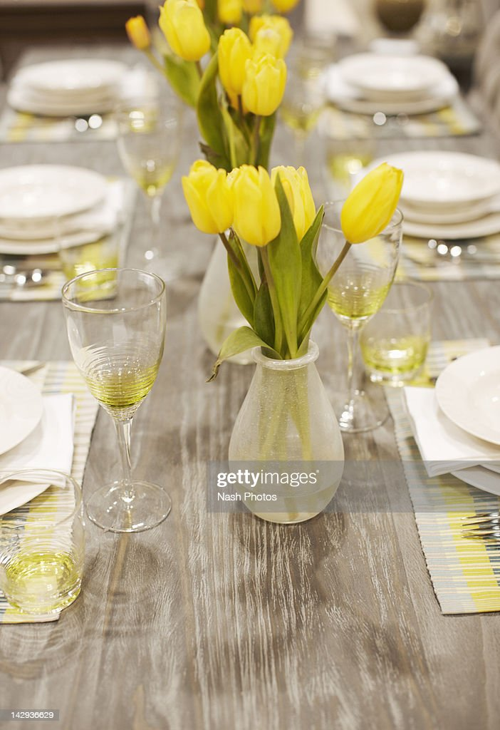 Table setting with yellow tulips : Stock Photo