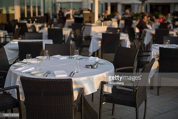 Table settings are laid out at a restaurant on the terrace at Harbour City shopping mall operated by Wharf Ltd in the Tsim Sha Tsui district of Hong...