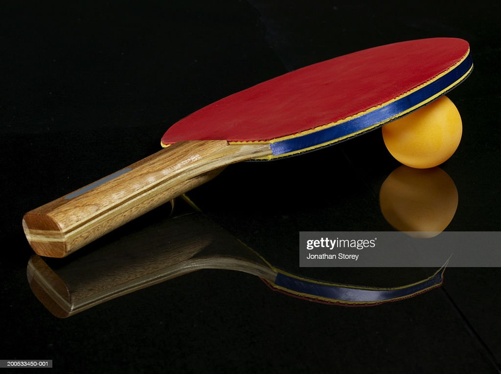 Table Tennis Bat And Ball Closeup Against Black Background
