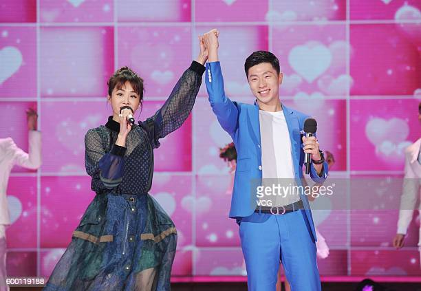 Table tennis Olympic champion Ma Long and singer Jolin Tsai perform during the recording of Hunan TV program 'Day Day Up' on September 7 2016 in...