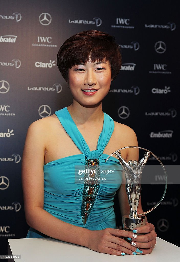 Table Tennis player Ding Ning poses with the trophy at the 2013 Laureus World Sports Awards at the Theatro Municipal Do Rio de Janeiro on March 11, 2013 in Rio de Janeiro, Brazil.