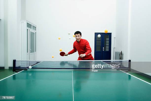 Table Tennis Player Hitting Multiple Balls