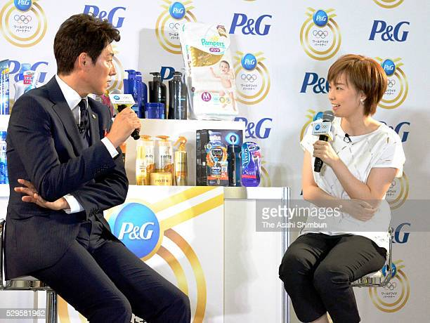 Table tennis player Kasumi Ishikawa talks with former tennis player Shuzo Matsuoka during the Mother's Day event on May 8 2016 in Tokyo Japan