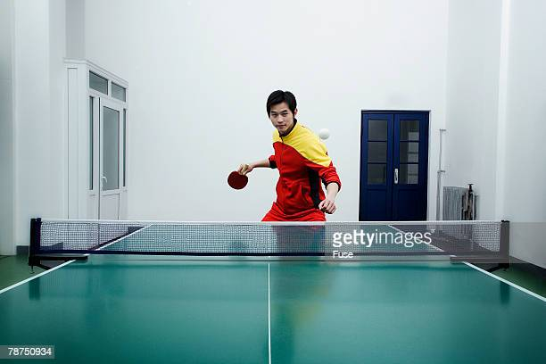 Table Tennis Player Preparing to Return Ball