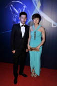 Table Tennis players Zhang Jike and Ding Ning attends the 2013 Laureus World Sports Awards at the Theatro Municipal Do Rio de Janeiro on March 11...