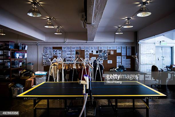 A table tennis table sits in front of a clothing rack at the Grana warehouse in Hong Kong China on Wednesday Oct 14 2015 Grana a Hong Kongbased...
