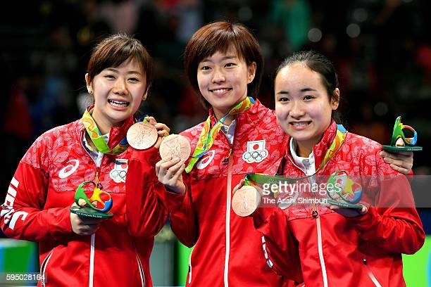 Table tennis Women's Team bronze medalists Ai Fukuhara Kasumi Ishikawa and Mima Ito of Japan pose for photographs after the medal ceremony on Day 11...