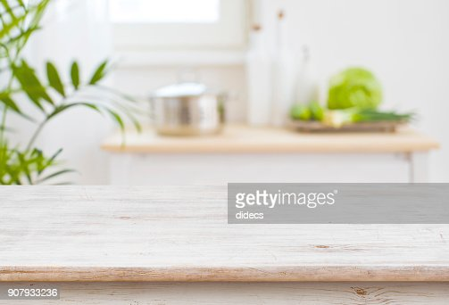 Table top and blurred kitchen room as background : Stock Photo