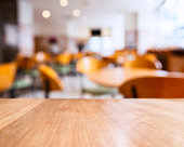 Table top counter and Seats Blurred People Restaurant Shop Cafe interior Background